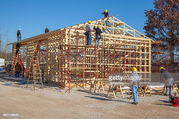 Team Of Man Framing a Building