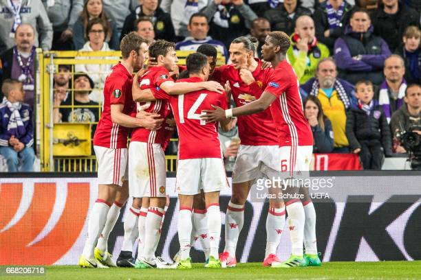 Team of Manchester celebrate their first goal during the UEFA Europa League quarter final first leg match between RSC Anderlecht and Manchester...