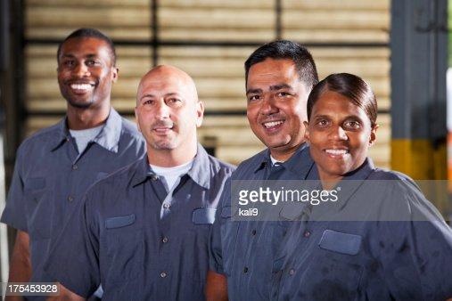 Team of mechanics in dark gray uniforms