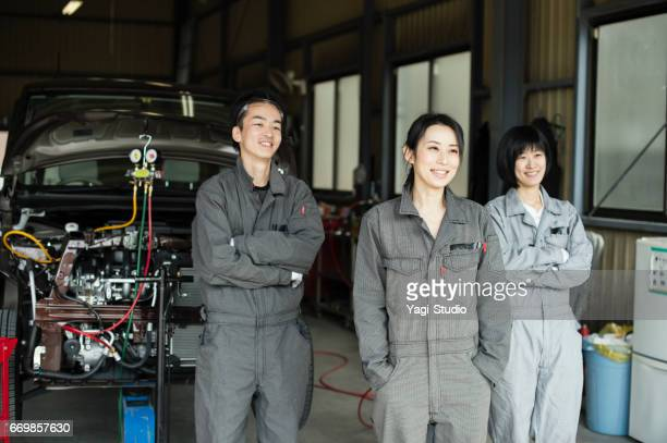 Team of mechanics working in an automotive repair shop