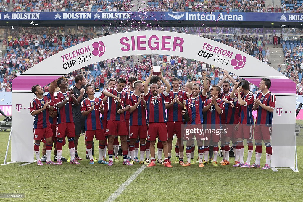 Team of Munich celebrates with the trophy after the Telekom Cup 2014 Finale match between FC Bayern Muenchen and Borussia Moenchengladbach at Imtech...