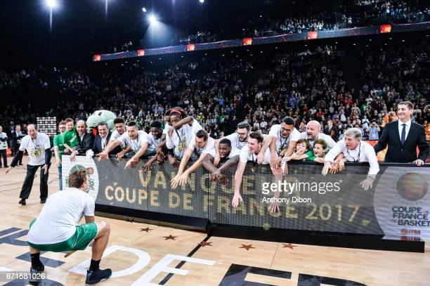 Team of Nanterre celebrates the victory with the trophy during the Final of the French Cup between Le Mans and JSF Nanterre at AccorHotels Arena on...