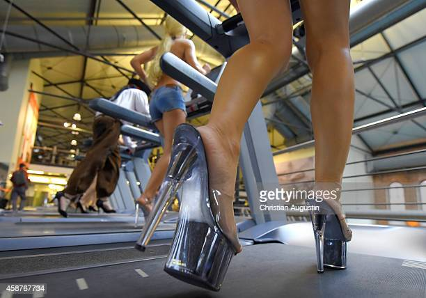 Team of nine women and one man set a world record of the longest distance running in high heels on a treadmill in thirty minutes at Holmes Place on...