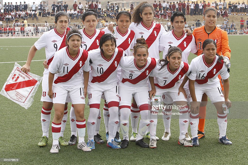 Team of Peru pose for a photo before a match between Peru and Bolivia in Women's U-20 football Qualifiers as part of the XVII Bolivarian Games Trujillo 2013 at Colegio San Jose on November 21, 2013 in Chiclayo, Peru.