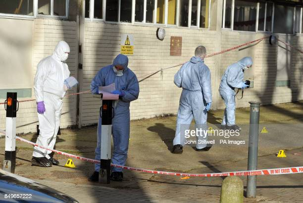 A team of police forensic officers search the entrance to Albon House in Wandsworth south west London where a 16yearold boy had been found stabbed to...