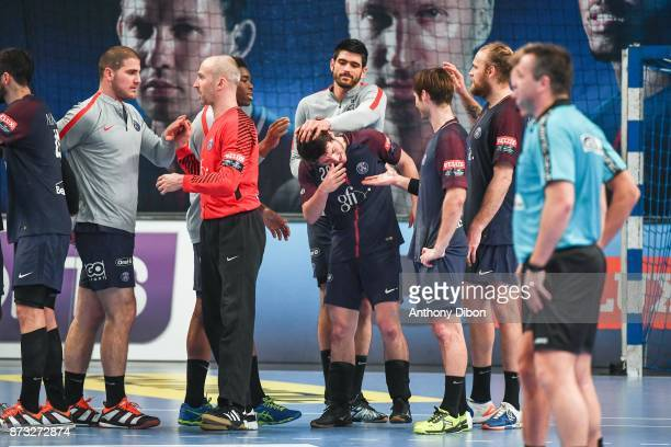 Team of PSG celebrates with Edouard Kempf during the Champions League match between Paris Saint Germain and Veszprem on November 12 2017 in Paris...