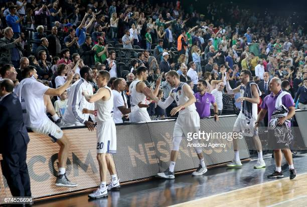 Team of Real Madrid celebrate their victory after the Turkish Airlines EuroLeague Playoffs Game 4 between Darussafaka Dogus and Real Madrid at...