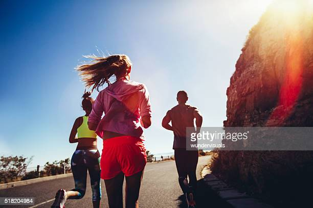 Team of runners training outdoors on summer
