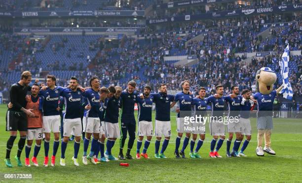 Team of Schalke celebrates after the Bundesliga match between FC Schalke 04 and VfL Wolfsburg at VeltinsArena on April 8 2017 in Gelsenkirchen Germany
