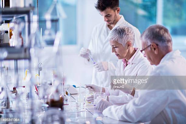 Team of scientists working on new scientific research in laboratory.