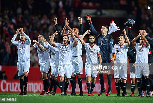 Team of Sevilla FC celebrates after winning the match against Real Madrid CF during the La Liga match between Sevilla FC and Real Madrid CF at...
