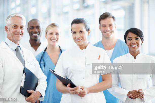 Team of successful doctors smiling at you