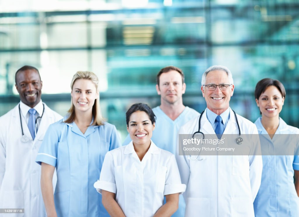 Team of successful doctors smiling together : Stock Photo