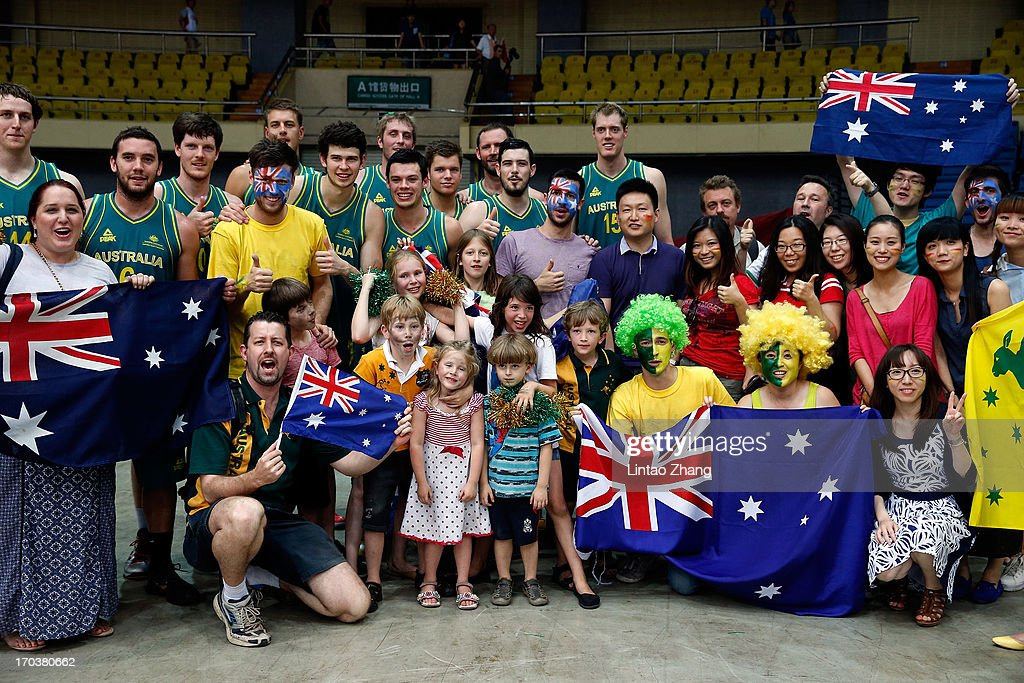 Team of the Boomers poses with fans for a photo after during game three of the series between the Australian Boomers and China at Tianjin Sports Center on June 12, 2013 in Tianjin, China.