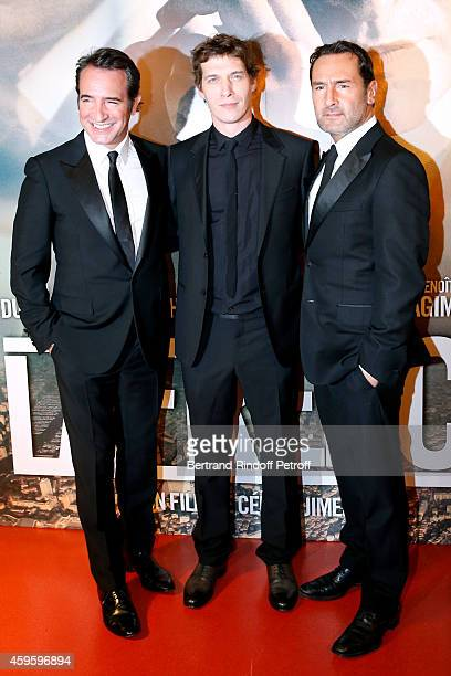 Team of the movie Actor Jean Dujardin Director Cedric Jimenez and actor Gilles Lellouche attend the 'La French' Paris Premiere Held at Cinema Gaumont...