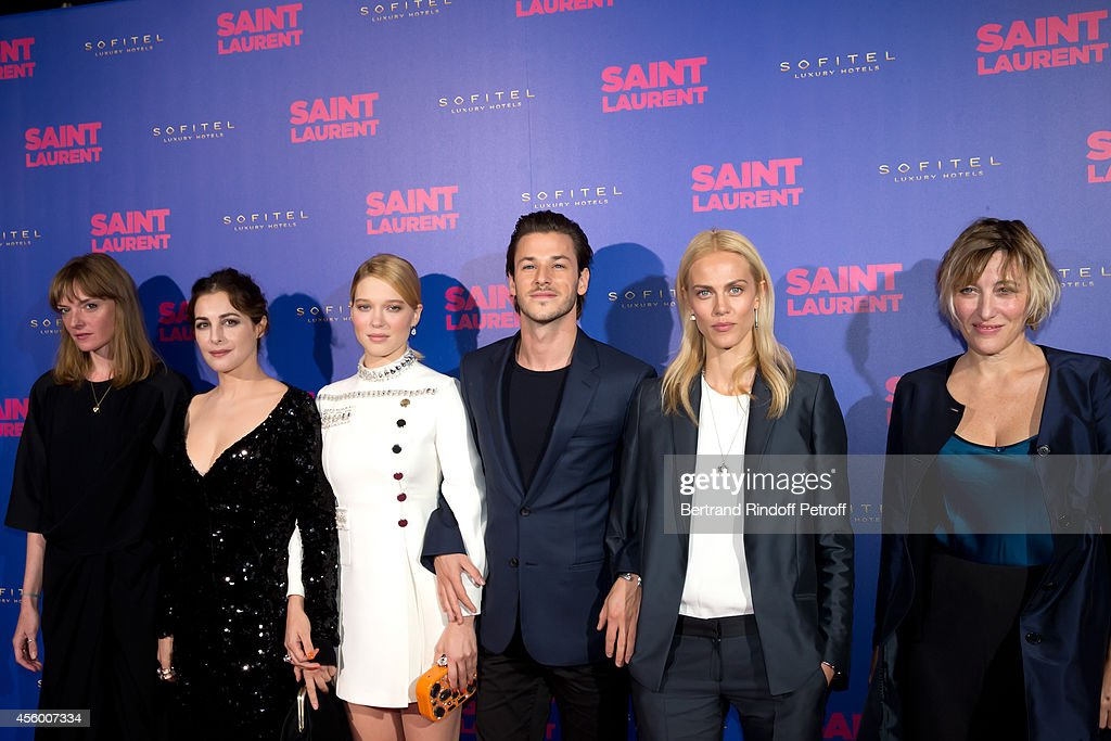 Team of the movie (L-R) actors Kate Moran, Amira Casar, Lea Seydoux (dressed in Miu Miu), Gaspard Ulliel, Aymeline Valade and Valeria Bruni Tedeschi attend the 'Saint Laurent' movie premiere at Centre Pompidou on September 23, 2014 in Paris, France.