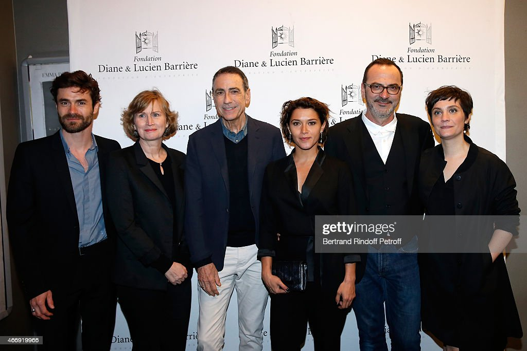 Actors Yannick Renier, Christine Brucher, Alain Chamfort, Emma de Caunes, Director Olivier Jahan and actress Jeanne Rosa attend movie 'Les Chateaux de Sable' receives Cinema Award 2015 of Foundation Diane & Lucien Barriere during the premiere of the movie at Publicis Champs Elysees on March 19, 2015 in Paris, France.