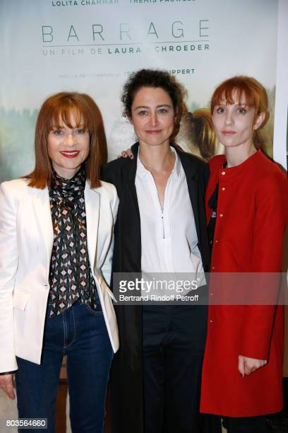 Team of the movie actress Isabelle Huppert director Laura Schroeder and actress Lolita Chammah attend the 'Barrage' Paris Premiere at UGC Odeon on...