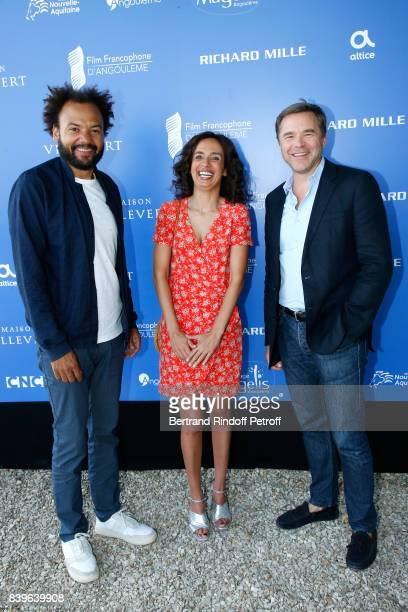 Team of the movie 'Coexister' director Fabrice Eboue actors Amelle Chahbi and Guillaume de Tonquedec attend the 10th Angouleme FrenchSpeaking Film...