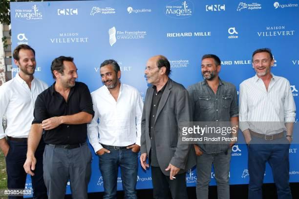 Team of the movie 'Le sens de la fete' actors Benjamin Laverhne Gilles Lellouche codirector Eric Toledano actor JeanPierre Bacri codirector Olivier...
