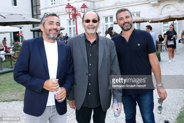 Team of the movie 'Le sens de la fete' Codirector Eric Toledano actor JeanPierre Bacri and codirector Olivier Nakache attend the 10th Angouleme...
