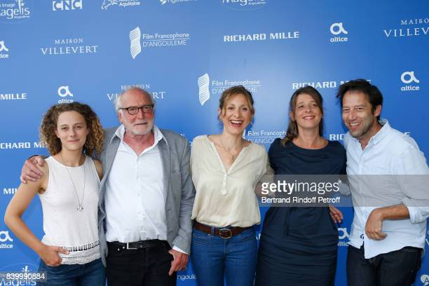 Team of the movie 'Otezmoi d'un doute' actors Alice de Lencquesaing Andre Wilms and director Carine Tardieu and guests attend the 10th Angouleme...