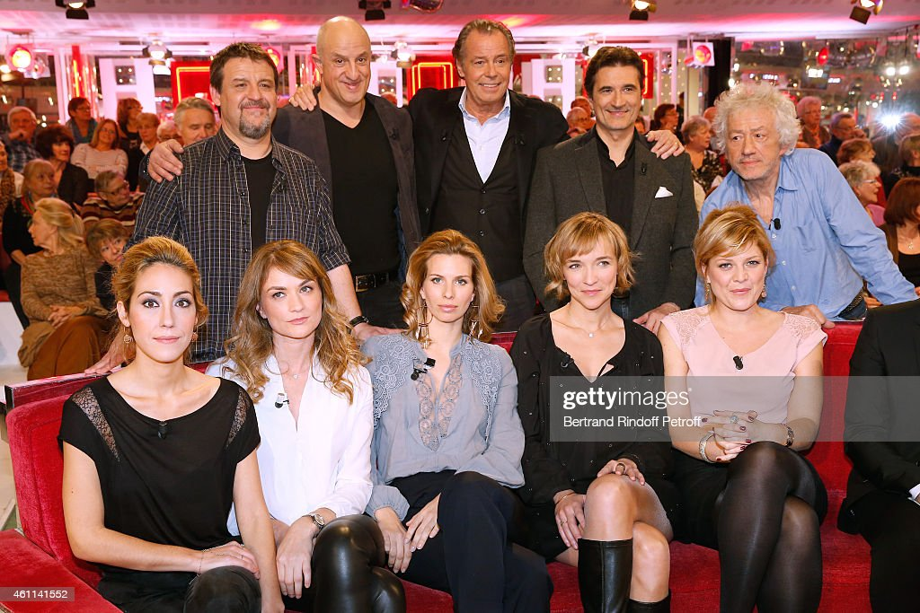 Team of the Theater Piece 'Le tombeur' : (Back L-R) Actors Guy Lecluyse, Chick Ortega, Main guest of the show Michel Leeb, Xavier Goulard, director Jean-Luc Moreau, (Front L-R) actresses Julia Duchaussoy (daughter of Duchaussoy), Coralie Audret, Laurence Porteil (daughter of Daniel Colas), Pascale Louange and Camille Solal attend the 'Vivement Dimanche' French TV Show at Pavillon Gabriel on January 7, 2015 in Paris, France.