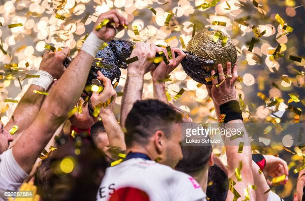 Team of Vardar celebrate with the trophy after winning the VELUX EHF FINAL4 Final match between Paris SaintGermain Handball and HC Vardar at Lanxess...