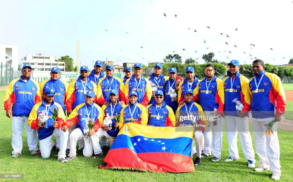 Team of Venezuela pose in the podium after winning the medals in baseball final match between Venezuela and Panama as part of the XVII Bolivarian Games Trujillo 2013 at Villa Deportiva Regional del Callao on November 24, 2013 in Lima, Peru.