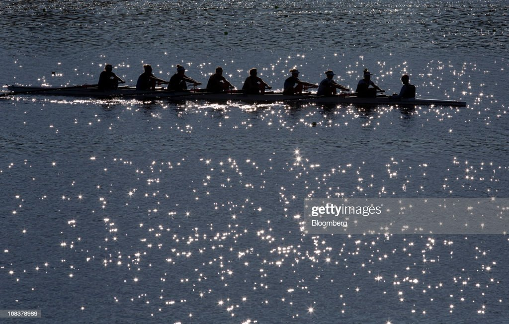 A team of women row on Lake Karapiro, upstream from the Karapiro hydroelectric power station operated by Mighty River Power Ltd., in Karapiro, New Zealand, on Wednesday, May 8, 2013. New Zealand raised NZ$1.7 billion ($1.4 billion) from the sale of Mighty River shares as the nation's biggest initial public offering closed at a price at the lower end of the indicative range. Photographer: Brendon O'Hagan/Bloomberg via Getty Images