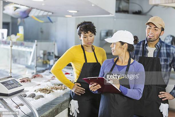 Team of workers in seafood market