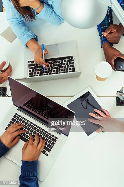 Team of young business people using technology in a meeting