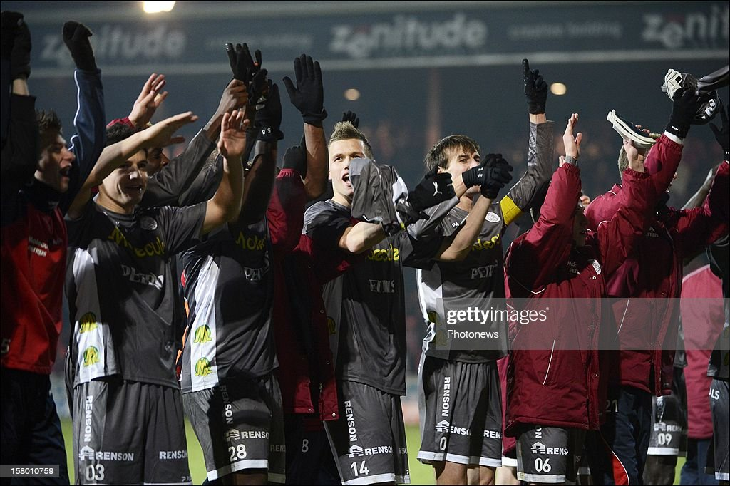 team of Zulte celebrating victory during the Jupiler League match between Kv Kortrijk and Zulte Waregem on december 08, 2012 in Kortrijk, Belgium.
