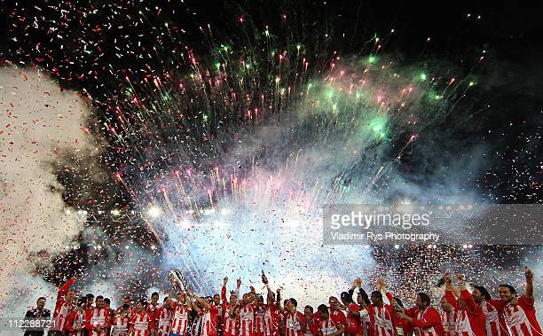 Team Olympiacos celebrates with the trophy after finishing first in the regular season and claiming it's historicaly 38th titel following the Super...