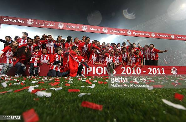 Team Olympiacos celebrates with the trophy after finishing first in the regular season and claiming it's historicaly 38th title following the Super...
