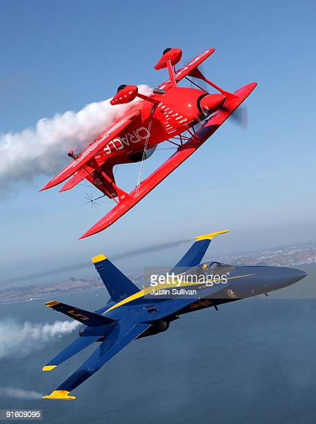 Team Oracle stunt pilot Sean Tucker and a US Navy Blue Angels F/A18 Hornet piloted by US Marine Corps Major Nathan Miller fly over the San Francisco...