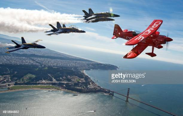 Team Oracle stunt pilot Sean Tucker flies ahead of the US Navy Blue Angels as part of a practice run for Fleet Week over the bay in San Francisco...