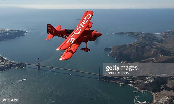 Team Oracle stunt pilot Sean Tucker flies over the Golden Gate bridge as part of a practice run for Fleet Week over San Francisco California on...