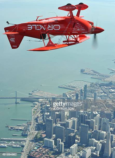 Team Oracle stunt pilot Sean Tucker flies upside down as part of a practice run for Fleet Week over San Francisco California on October 8 2015 Fleet...