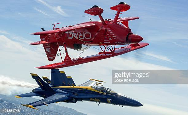 Team Oracle stunt pilot Sean Tucker flies upside down over US Navy Blue Angels Captain Tom Frosch as part of a practice run for Fleet Week over San...