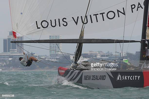 Team Origin crew member clears a line from Great Britain during their race against Damiana Italia Challenge during round robin 2 on day five of the...