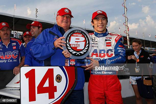 Team owner AJ Foyt and Takuma Sato of Japan driver of the ABC Supply AJ Foyt Racing Honda pose with Verizon P1 Pole Award for the Verizon IndyCar...