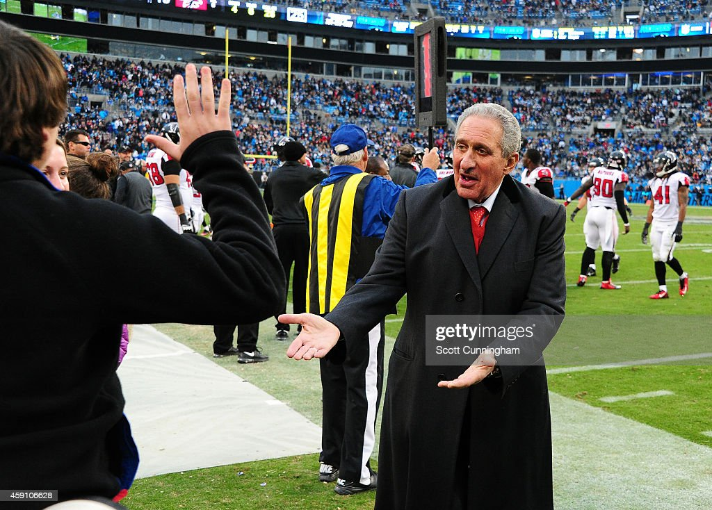 Team Owner Arthur Blank of the Atlanta Falcons celebrates with family members late in the game against the Carolina Panthers at Bank Of America...