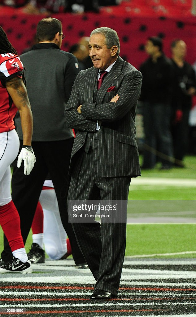 Team Owner Arthur Blank of the Atlanta Falcons paces the field during warmups for the game against the Carolina Panthers at the Georgia Dome on...