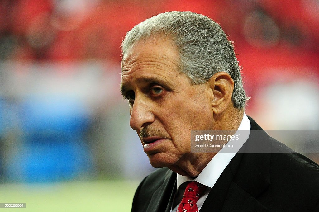 Team owner <a gi-track='captionPersonalityLinkClicked' href=/galleries/search?phrase=Arthur+Blank&family=editorial&specificpeople=1278336 ng-click='$event.stopPropagation()'>Arthur Blank</a> walks on the field prior to the game against the New Orleans Saints at the Georgia Dome on January 3, 2016 in Atlanta, Georgia.