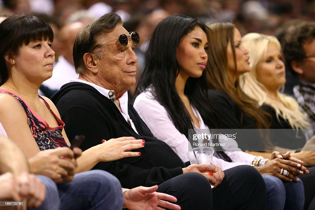 Team owner Donald Sterling of the Los Angeles Clippers and V. Stiviano watch the San Antonio Spurs play against the Memphis Grizzlies during Game One of the Western Conference Finals of the 2013 NBA Playoffs at AT&T Center on May 19, 2013 in San Antonio, Texas.