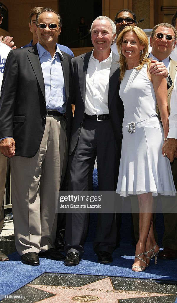 Team owner Frank McCourt and wife Jamie pose with manager Joe Torre and former manager Tommy Lasorda at a special star ceremony honoring the Los...