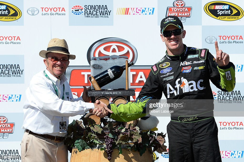 Team owner Jack Roush and Carl Edwards, driver of the #99 Aflac Ford, celebrates in victory lane after winning the NASCAR Sprint Cup Series Toyota/Save Mart 350 at Sonoma Raceway on June 22, 2014 in Sonoma, California.