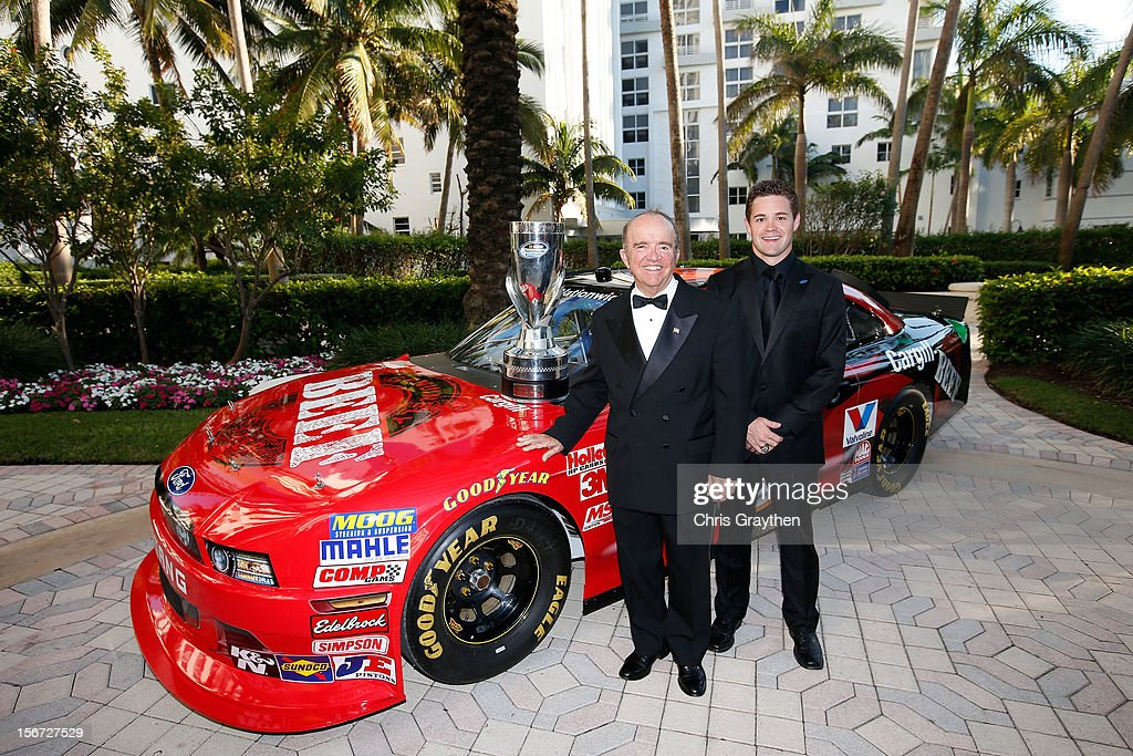 Team owner Jack Roush and Nationwide Series Champion Ricky Stenhouse Jr. poses next to the #6 Ford prior to the NASCAR Nationwide Series And Camping World Truck Awards Banquet at Loews Miami Beach on November 19, 2012 in Miami Beach, Florida.