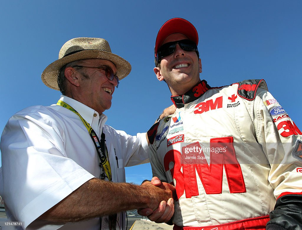 Team owner Jack Roush (L) congratulates Greg Biffle (R), driver of the #16 Pure Michigan Ford, after qualifying for the pole position in the NASCAR Sprint Cup Series Pure Michigan 400 at Michigan International Speedway on August 19, 2011 in Brooklyn, Michigan.